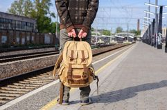 Young man waits train on railway station Stock Photography