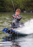 A young man wake-boarding Royalty Free Stock Photos