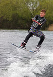 A young man wake-boarding Royalty Free Stock Photography