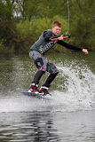 A young man wake-boarding / surfing Stock Image