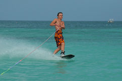 Young Man on a Wakeboard off the Coast of Aruba Royalty Free Stock Photography