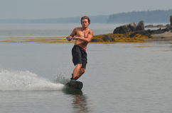 Young Man Wakeboarding in Casco Bay on a Summer Day. Wakeboarding on a summer day in Maine Stock Photos