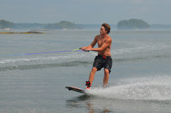 Young Man Wakeboarding in Maine`s Casco Bay. Young guy wakeboarding in Casco Bay Maine Royalty Free Stock Images