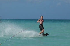 Young Man Wakeboarding in Tropical Waters of Aruba. Aruba with a young guy wakeboarding in the tropics Stock Photography