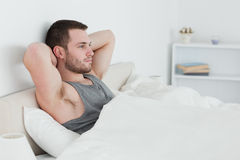 Young man waking up Royalty Free Stock Image
