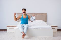 The young man waking up in bed. Young man waking up in bed Stock Images