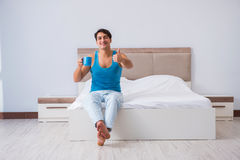 The young man waking up in bed. Young man waking up in bed Stock Photography