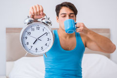The young man waking up in bed. Young man waking up in bed Royalty Free Stock Photos