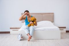 The young man waking up in bed Royalty Free Stock Photos