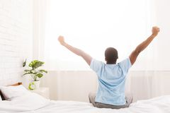 Free Young Man Waking Up In Bed And Stretching His Arms Stock Photos - 133918193