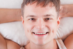 Young man waking up in the morning in good mood. smiling Royalty Free Stock Photos