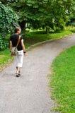 Young man walking Stock Image