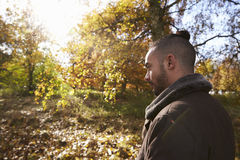 Young Man Walking In Autumn Woodland Royalty Free Stock Photos