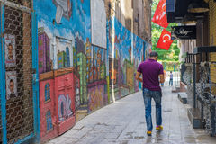 Young Man Walking in Back Street, Istanbul Royalty Free Stock Photography