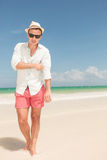 Young man walking on the beach Royalty Free Stock Photos