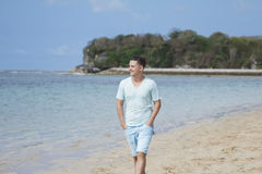 Young man walking by at the beach Royalty Free Stock Photos