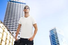 Young man walking in city. Young handsome man walking in city Stock Photos