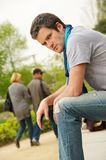 Young man and walking couple. On a blurred background Stock Image