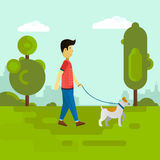 Young man walking with dog in the park. Stock Photos