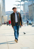 Young man walking Stock Images