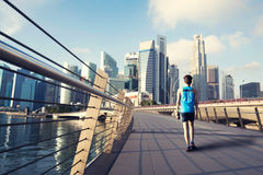 Young man walking exercise along bridge near Marina bay in Singapore. Young man exercise walking along bridge near Marina bay in Singapore with Singapore Stock Images