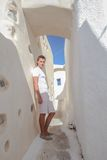 Young man walking in narrow streets of Emporio Stock Image