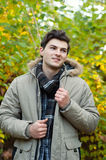 Young man walking in park Stock Photography