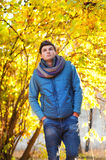 Young man walking in park Stock Image