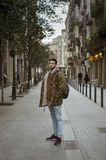 Young man walking on the street Royalty Free Stock Images