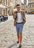 Young man walking on town Stock Photos