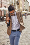 Young man walking on town Royalty Free Stock Photo