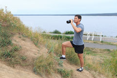 A young man walking on the trail. travel sport lifestyle concept. Young athlete drinking fresh water Stock Photo