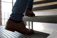 Young man walking up stairs. Stock Photo