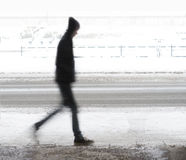 Young man walking in winter Stock Photos