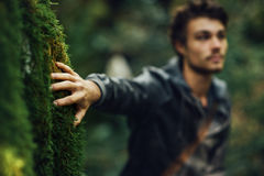 Young man walking in the woods Stock Photography