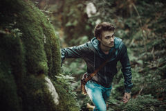 Young man walking in the woods royalty free stock photos