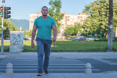 young man walking on zebra crossing Royalty Free Stock Photo