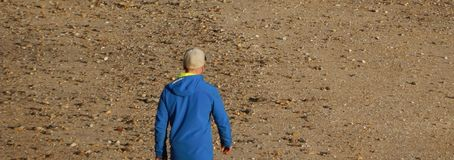 young man walks on the sand stock images