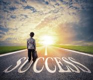 Young man walks on a success way. Concept of successful businessman and company startup royalty free stock images