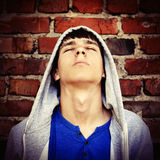 Young Man by the Wall Stock Photography