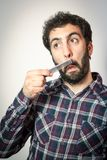 Young man want comb his beard and moustaches Stock Photo