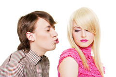 Young man want to kiss inaccessible blonde Royalty Free Stock Image