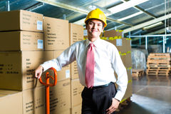 Young Man in warehouse he is a manager Royalty Free Stock Photo