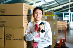 Young Man in a warehouse with Scanner Stock Image
