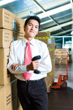 Young Man in a warehouse with Scanner Royalty Free Stock Photo