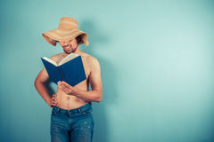 Young man waring hat is reading Stock Image