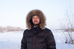 Young man in warm clothes Stock Photos