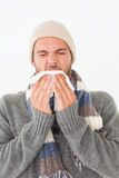 Young man in warm clothing sneezing Royalty Free Stock Photography