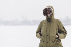 Young man in warm jacket. In a cold winter day Royalty Free Stock Images