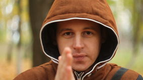 The young man warming his hands stock footage
